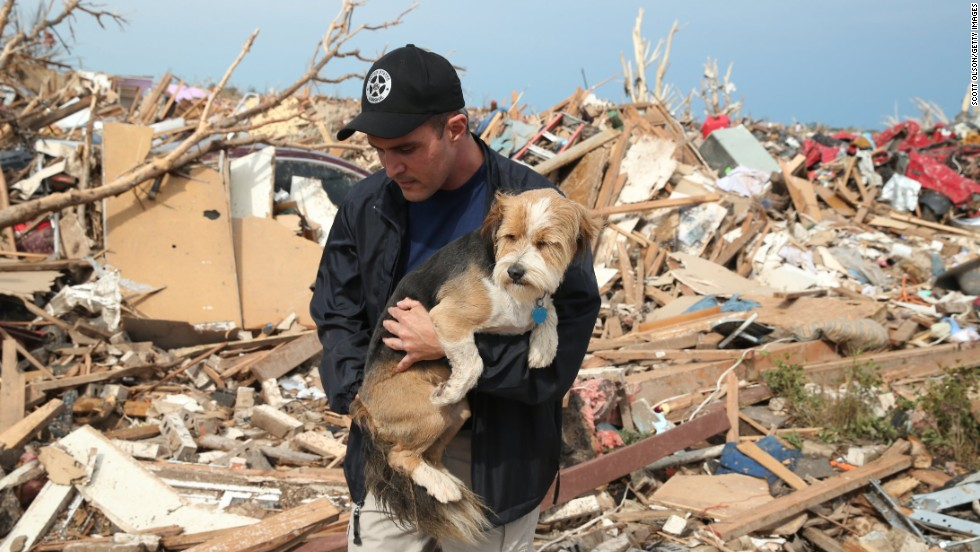 Sean Xuereb recovers a dog from the rubble of a home that was destroyed by the massive tornado that hit Moore, Oklahoma, on Monday, May 20. A website has been set up to help <a href='http://www.okclostpets.com' target='_blank'>lost and found pets</a>, and shelters have been set up to help displaced and injured animals. For ways to help, visit <a href='http://www.cnn.com/SPECIALS/impact.your.world/'>CNN.com/impact.</a>