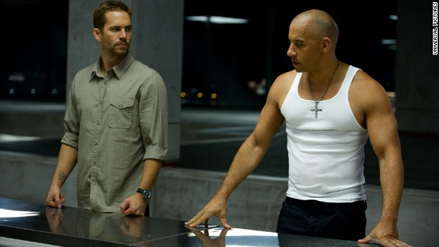 "Walker, left, and Vin Diesel appear in a scene from ""Fast & Furious 6."" Walker's role as Brian O'Conner in the franchise helped to make the actor a star."