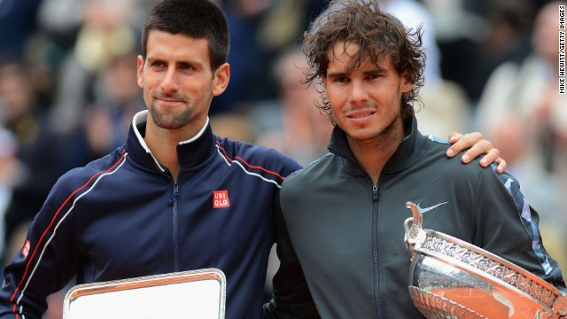 Rafael Nadal celebrates his French Open title success in 2012 with runner-up Novak Djokovic.