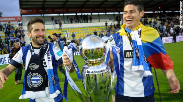 Rodriguez joins Real from French club Monaco, where he spent just one season after signing in a $60 million deal from Porto in May 2013. Here Joao Moutinho, who Monaco signed at the same time as the Colombian, and Rodriguez are pictured holding the Portuguese league trophy after Porto's 2013 triumph.