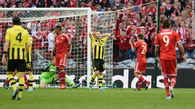 Borussia Dortmund's Polish midfielder Jakub Blaszczykowski, center, reacts after missing a goal against Dortmund.