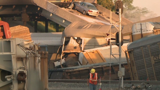 Train collision causes overpass collapse
