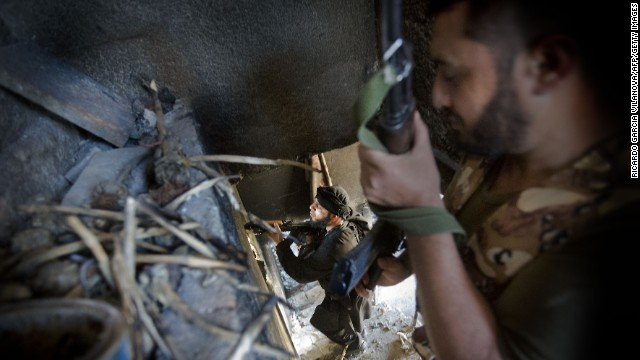 Syrian rebels take position in a damaged house during clashes with regime forces in Aleppo on Wednesday, May 22. Tensions in Syria first flared in March 2011 during the onset of the Arab Spring, eventually escalating into a civil war that still rages. This gallery contains the most compelling images taken since the start of the conflict.