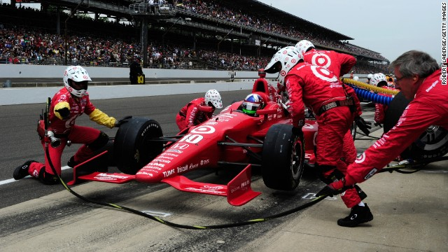 Dario Franchitti's No.10 stops in the pit.