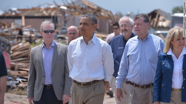 Obama tours a tornado-affected area on Sunday, May 26, in Moore, Oklahoma. A tornado that ripped through Moore outside Oklahoma City on Monday, May 20, hit 2,400 homes on a 17-mile path.