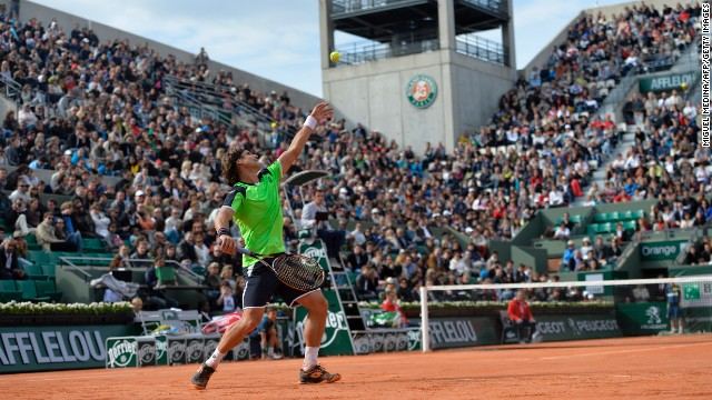 Spain's David Ferrer serves to Australia's Marinko Matosevic during the first round of the French Open on Sunday, May 26, in Paris. Ferrer won the match 6-4, 6-3, 6-4.