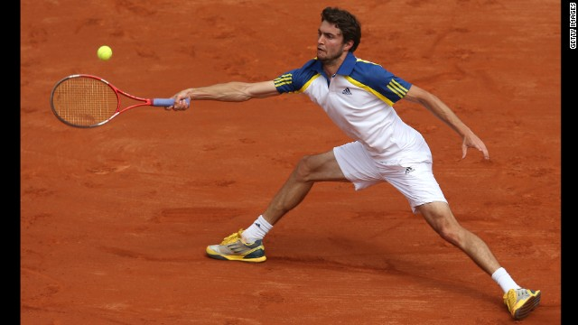 Gilles Simon of France reaches to make a forehand return against Lleyton Hewitt of Australia on May 26. Simon won 3-6, 1-6, 6-4, 6-1, 7-5.