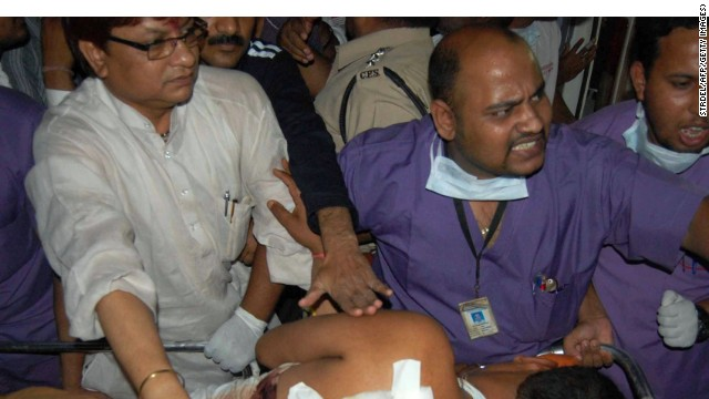 Indian medical staff carry an injured victim early May 26 after an ambush on a convoy of Congress Party leaders in Chhattisgarh.
