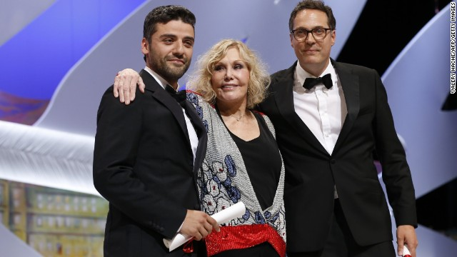 "Actor Oscar Isaac, left, poses on stage with actress Kim Novak after he received the Grand Prix for the film ""Inside Llewyn Davis"" on behalf of U.S. directors Joel and Ethan Coen. The Grand Prix is the second-highest honor for a film at the festival."
