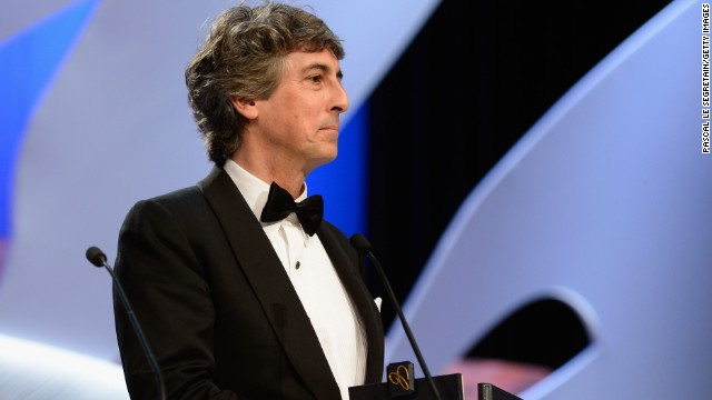 Director Alexander Payne holds the 'Prix D'Interpretation Masculine' (best performance by an actor) which he accepted on behalf of Bruce Dern for his performance in 'Nebraska.'
