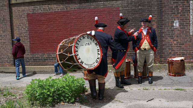 Members of the Mattatuck Drum Band, billed as the country's oldest fife and drum band, warm up before joining the Memorial Day parade in Waterbury on May 26.