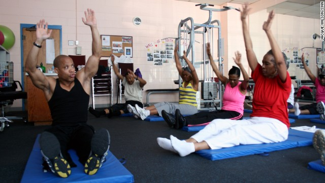 "Personal trainer Leslie Magnum, left, teaches functional fitness classes at Quality Living Services' senior center in Atlanta. Magnum, who is the owner of Young at Heart Wellness, says regular physical activity helps seniors tackle everyday tasks. ""People need to know that seniors are living. They want to live. They don't want to sit around and not do anything."""