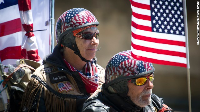Motorcyclists wave American flags during the Rolling Thunder event in Washington on May 26.