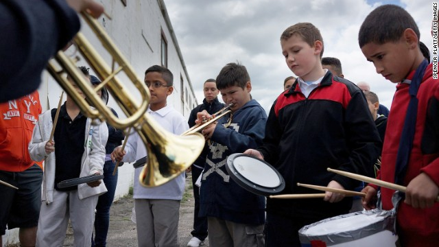 Children warm up with their instruments before joining a Memorial Day parade May 26 in Waterbury, Connecticut.