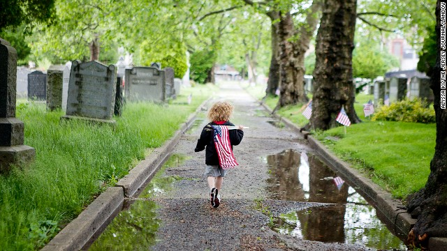 Jahvanni Gifford, 4, walks through Bayview Cemetery in Jersey City on May 25.
