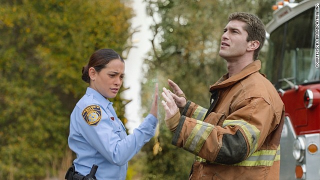 "Deputy Linda (Natalie Martinez) and her fiancé, Rusty (Josh Carter), find themselves separated by a massive transparent dome that's suddenly fallen on the town of Chester's Mill on CBS's ""Under The Dome."""