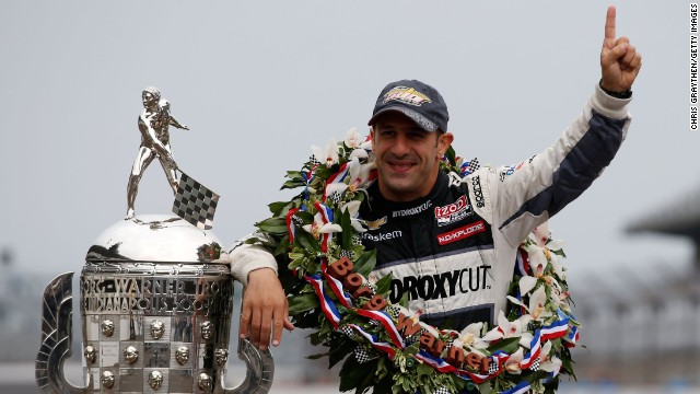 "Indianapolis 500 Champion Tony Kanaan of Brazil poses with the Borg Warner Trophy at the Indianapolis Motor Speedway's ""yard of bricks"" on Monday, May 27."