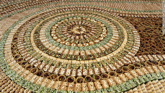 This picture shows part of a mosaic of traditional Arabic sweets, measuring 112 meters long, which entered the Guinness Book of World Records as the biggest of its kind on July 14, 2010 in Damascus, Syria.