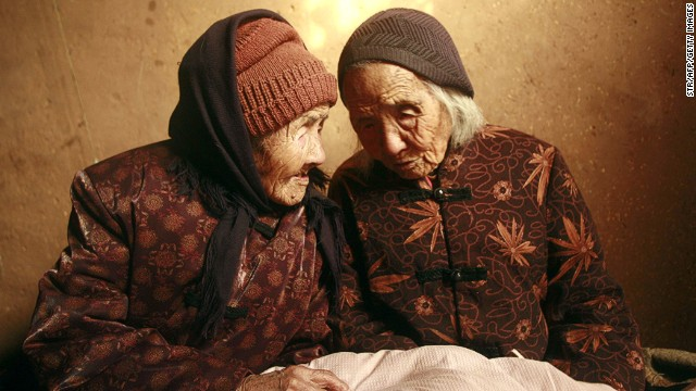 At 104 years of age, Chinese twin sisters Cao Daqiao (right) and Cao Xiaoqiao are listed as the oldest living twins in the world. They are pictured at home in Weifang, east China's Shandong province, on November 29, 2009.