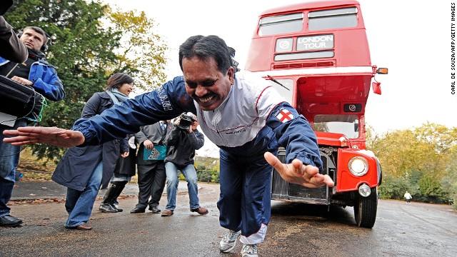 Strongman Manjit Singh, 59, pulls a double decker bus using ropes attached to his hair, in London, on November 12, 2009. Singh broke the world record Thursday by pulling the bus a total of 21.2 meters.
