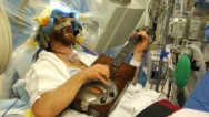 Man plays guitar during brain surgery