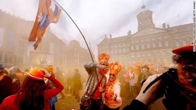 Dutch celebrating the investiture of the country's new king in Amsterdam on April 30.