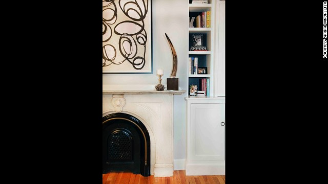 Pair vintage home features like a marble fireplace with modern art for a sharp contrast and marriage of eras.