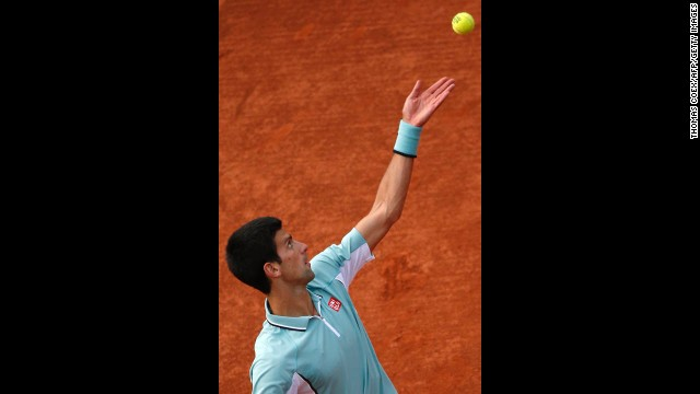 Djokovic serves to Goffin during their first round match on May 28.
