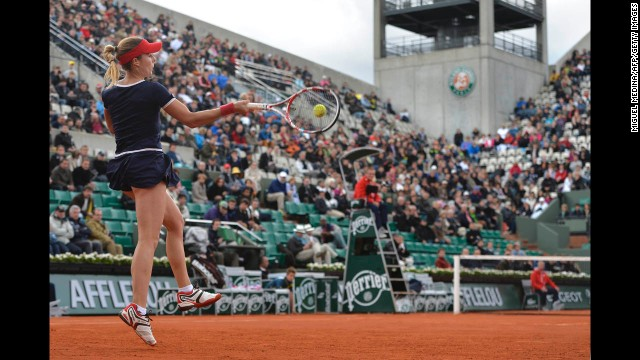 France's Alize Cornet returns to Portugal's Maria Joao Koehler during their first round match on May 28.