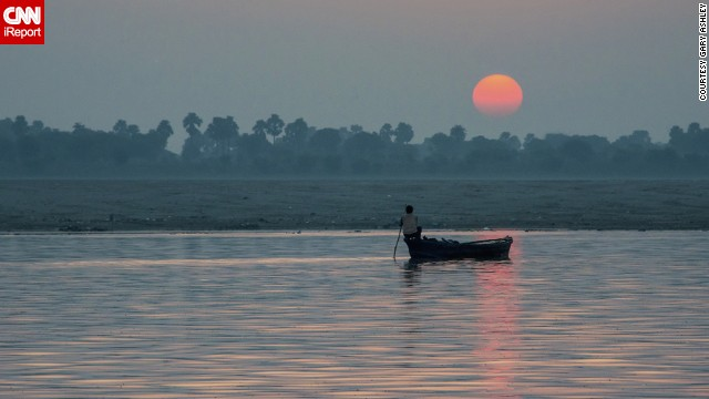 """Just for this moment, there was a tranquility that I have experienced nowhere else,"" says Gary Ashley of watching the sunrise from a rowboat on the <a href='http://ireport.cnn.com/docs/DOC-953637'>Ganges</a>."