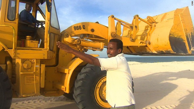 Somali hotelier Bashir Osman (front) wants to attract holidaymakers from around the world by building a seaside luxury resort in Mogadishu.