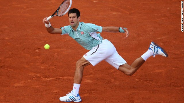 Novak Djokovic of Serbia plays a forehand against David Goffin of Belgium during day three of the French Open at Roland Garros stadium in Paris on Tuesday, May 28. Djokovic defeated Goffin 7-6(5), 6-4, 7-5.