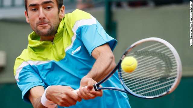 Croatia's Marin Cilic hits a backhand shot to Australia's Nick Kyrgios on May 29. Cilic won 6-4, 6-2, 6-2.