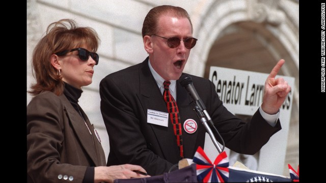 Bachmann and Bill Wenmark address a crowd on the steps of the Minnesota state Capitol in St. Paul in April 1999.