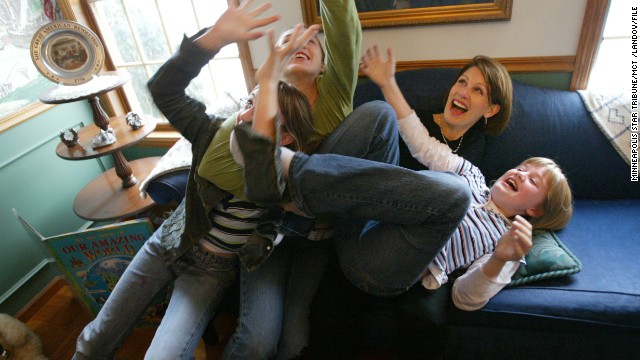 Bachmann plays with daughters, from left, Caroline, Elisa and Sophia at their home in Stillwater, Minnesota, in December 2004.