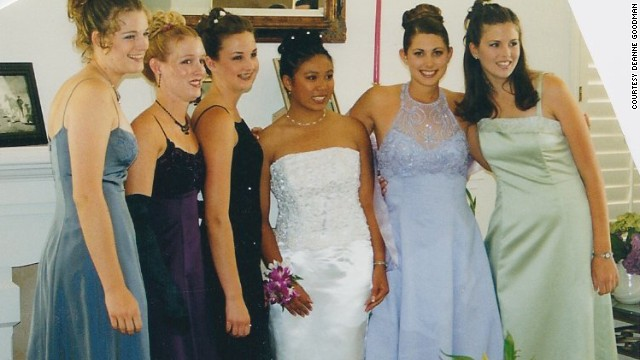 2000: <a href='http://ireport.cnn.com/docs/DOC-605993'>Deanne Goodman</a>, in lavender, still really likes her dress, even though she says it's outdated by more than a decade. The friendships with those in the picture haven't faded away either.