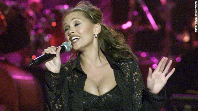 Vanessa Williams stepped down in 1984 as the first black Miss America after nude photos of her appeared in Penthouse magazine. She went on to a successful singing and acting career, and has written a memoir. Pictured, Williams performs in November 2000.
