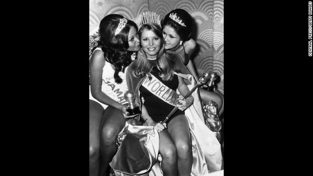 Marjorie Wallace lost her Miss World 1973 title because the organization said dating celebrities like Tom Jones during her reign threatened its reputation. She had entered the pageant as Miss America. Pictured, Wallace celebrates with Miss Jamaica Patricia Yuen, left, and Miss Philippines Margarita Moran after she is crowned Miss World.