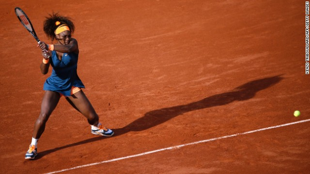 Serena Williams of the United States hits a shot to Caroline Garcia of France on May 29. Williams won 6-1, 6-2.