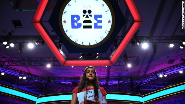 "Minka Gill of Kokomo, Indiana, spells ""corpuscle"" during round two on May 29. A corpuscle mean a minute or elementary particle or a living cell that is isolated and not a continuous part of other tissue -- like a red or white blood cell."