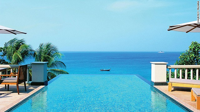 At Trisara, all-glass French doors open onto a 32-foot-long cerulean plunge pool that appears to drip into the Andaman Sea.