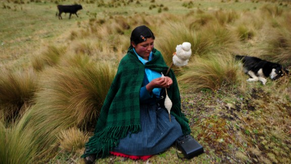 An Andean woman spins wool in front of the Perol lagoon at the Conga mine in Cajamarca on November 23, 2011.
