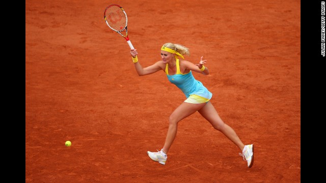 Kristina Mladenovic of France plays a forehand to Samantha Stosur of Australia on May 30.