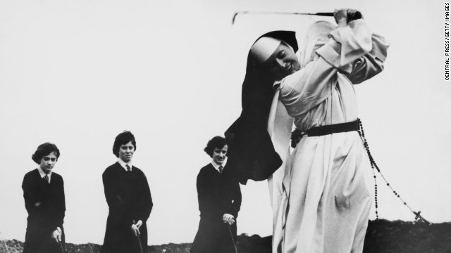 Nun and golf coach, Sister Mary Martina was a regular on the course. Here she shows students how to take an iron shot while on the golf course at Rosebud Country Club, Portsea, Victoria, Australia back in in 1965.