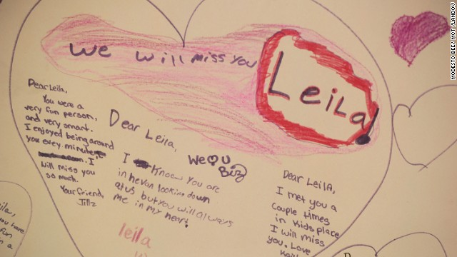 People leave notes at the memorial for Leila.