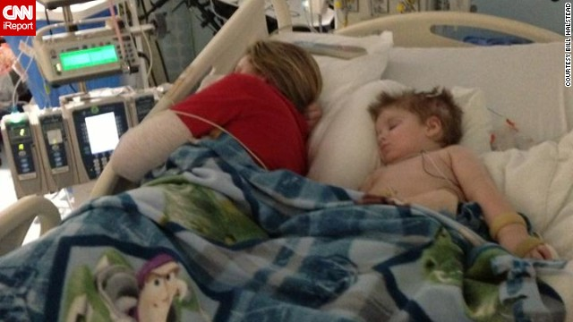 Halstead takes a nap next to Tripp in the ICU in early March.