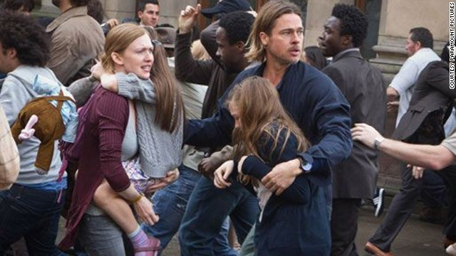 "If a family is going to be placed in peril, there must be an equal child-to-parent ratio; that way, everyone is assigned a buddy when all hell breaks lose. Here, Mireille Enos as Karen Lane and Brad Pitt as Gerry Lane in ""World War Z"" each grab hold of a kid."
