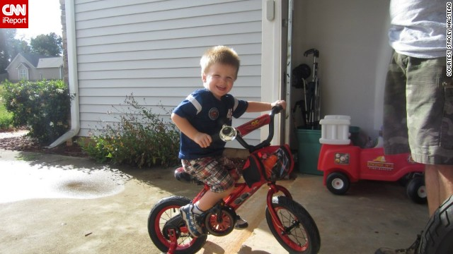 "August 2011: Tripp Halstead rides his new bike outside his home in Winder, Georgia. The bike, a gift from Tripp's grandfather, was inspired by Lightning McQueen from the movie ""Cars,"" Tripp's favorite movie character."