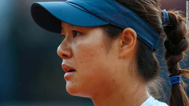 A disconsolate Li Na is headed for defeat in her second round match against Bethanie Mattek-Sands in Paris.