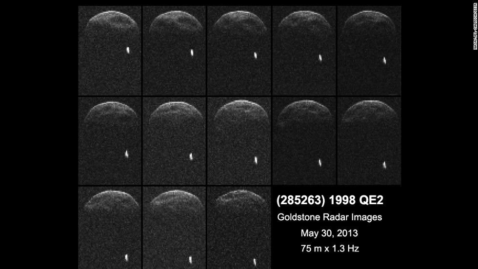 Asteroid 1998 QE2 about 3.75 million miles from Earth. The white dot is the moon, or satellite, orbiting the asteroid.